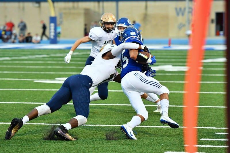 Hayden football player tackling opponent
