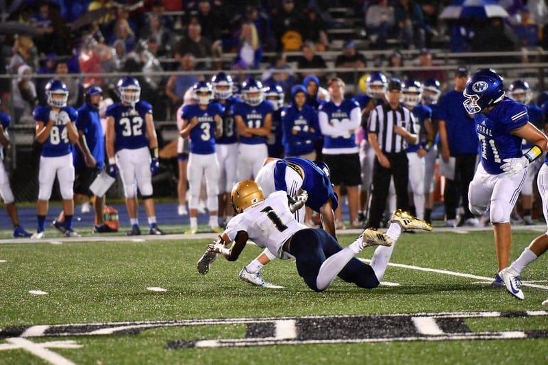 Hayden football player tackling