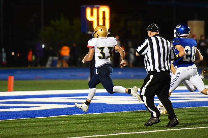 Hayden football player running