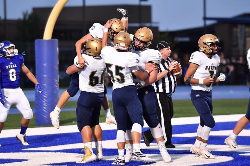 Hayden football team celebrating play