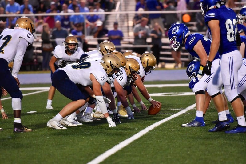 Hayden football team on the offensive line