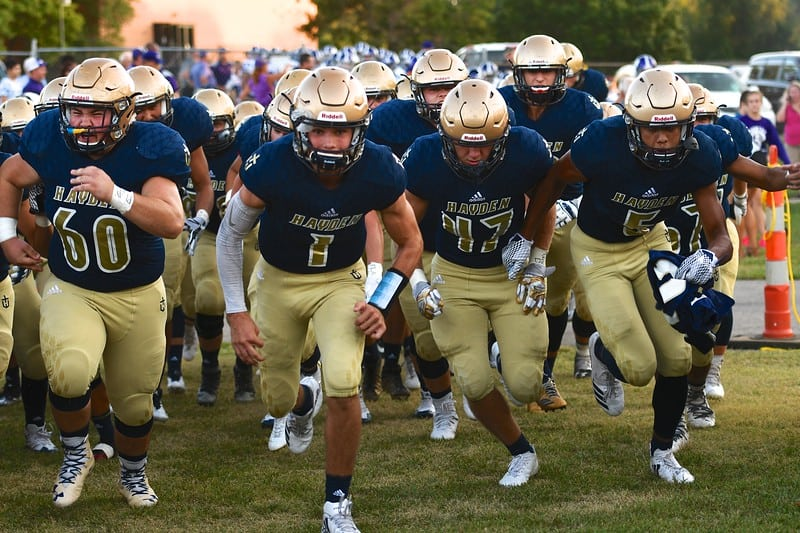 Hayden football team running onto field